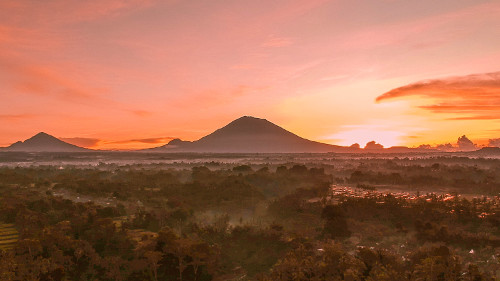 Sunrise over the rice terraces with Mt. Agung in the Background in Ubud, Bali, Indonesia