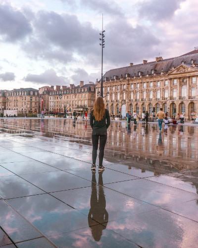 Reflection at Miroir d'Eau during sunset in Bordeaux, France